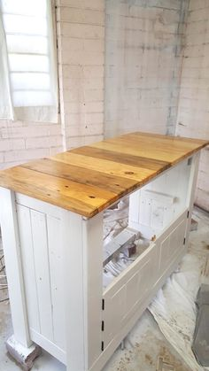 repurposed pallet wood turns into kitchen cabinet