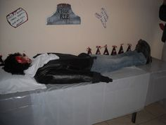 This is a life size dummy we created for my Rocky Horror Picture show party.We stuffed this guy with loads of newspaper,into the boots,jeans,shirt,jacket everywhere!For the head we bought a mask with hair on & just touched up with a bit of fake blood.The cool part: make sure to leave the stomach area empty with no stuffing as you can use a bowl filled with gooey stuff inside!Disgustingly delish!