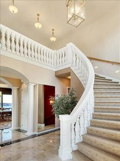 Probably not this fancy but I'd love a curved staircase