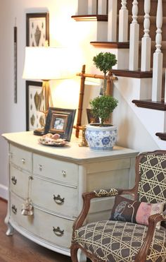 Great example of how to fill in that little, awkward spot next to staircase - Jill Hinson Interiors