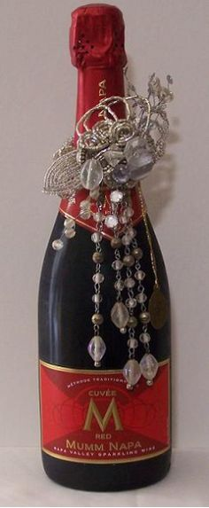 Available at Wine-Fi Wine Bottle Jewelry - Crystal (does look good on that Mumm Napa Red Cuvee )