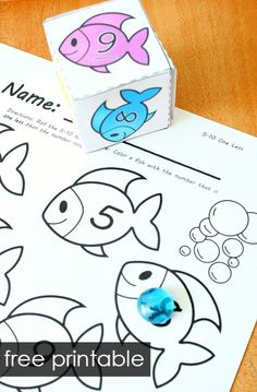 These fish theme roll and color math games are so much fun for kids! Great for practicing number sense, counting, shapes, number words and more in preschool and kindergarten Fish Activities, Counting Activities, Summer Activities For Kids, Fish Games For Kids, Preschool At Home, Math Games, Preschool Activities, Fun Games, Maths