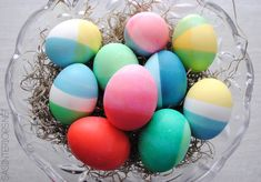 Create colorful EASTER EGGS using food coloring to get vibrant + vivid  Dip-Dyed Easter Eggs.  It's easy to do + KIDS will LOVE it. Read the tutorial now or Pin for Later!