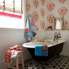 Thinking of wallpaper on top half of wall like this in the bathroom