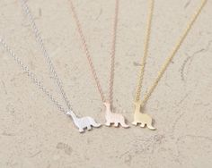 """Sometimes, your dinosaur necklace needs a dino friend! 