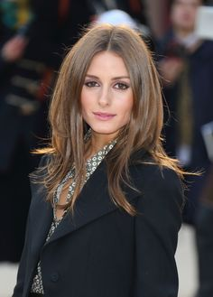 Olivia opted for a silky blow-dry and aubergine shadow at Burberry Prorsum.