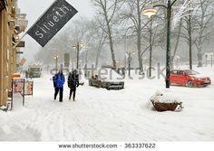HELSINKI, FINLAND - JAN 12,2016: Snowfall and blizzard in heart of Helsinki in Esplanadinpuisto park and parallel one-way streets on its sides named Pohjoisesplanadi and Etelaesplanadi