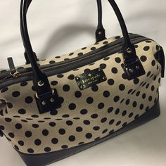 Kate spade polka dot handbag Excellent condition, the interior is pristine. I never put make up or ink pens in my bags, ever, so it is adorable and perfect inside. Who can resist the red? There is minor wear on brass nobs and a tiny, barley noticeable scuff in the bottom corner on the leather. kate spade Bags Shoulder Bags