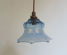 English pendant light in the original patinated brass finish complemented by period blue opalene glass shade. c 1900