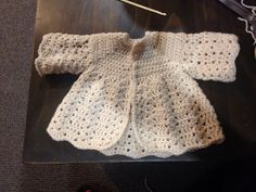 I am a beginner and I did my first baby garment from the pattern I found here on Pinterest at http://www.crochet-patterns-free.com/2013/04/crochet-baby-jacket-cardigan-free.html