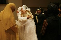 Mother and daughter greet for the last time as the Hadjis escort the Newly wed bride off the stage to start her new life as a married woman