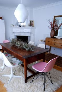 Dining room, now this is very eclectic you got a couple of beautiful rich wood tone antiques. then couple farm chairs a modern chair. well its just a mix. but thats what i love now. using pieces you love and you can live on.. and live with...