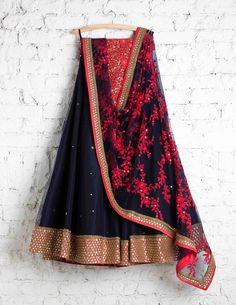 Love the colour combination, sparsely sequined lehenga and heavily embroidered dupatta.Not to forget the red threadwork blouse.