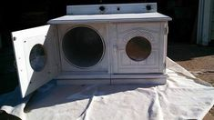 repurposed tv stand as a kid's luandry washer/dryer