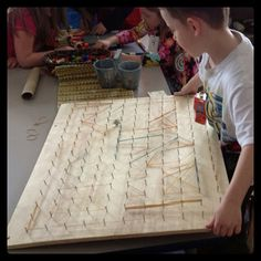 The provocation- Giant geoboard, rubber bands, lego board, legos, and marbles