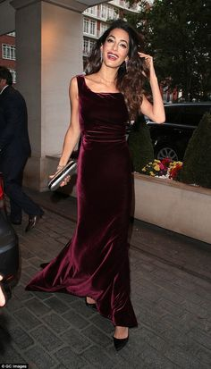 Glowing: Amal Clooney looked the epitome of happiness as she arrived for the WAAAUB Uk Cha...