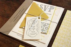 Whimsical yellow and gray wedding invitation.