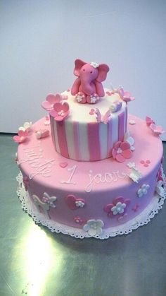 With pink elephant. I want this cake for Kylie's first birthday! I just don't know where to get it or how to make it...
