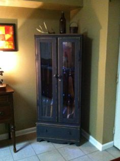 Gun Cabinet we painted for a customer. Love the black..makes it a little more feminine.