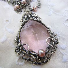 enchanted pendant~handmade stering silver wire pink crystal necklace by ErikaLyn~GRJ &Cu29, via Flickr