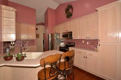 Perfect place for Bar Stools! Rich Wood Flooring in the Kitchen. Home For Sale: 6BD 3BA featuring a Lower Level 3BD Apartment! Contact Agent: Dorothy Bell Call/Text 801-493-9090 MLS# 1249942 56 Heron Ct., Saratoga Springs, UT 84045