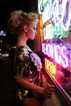 Happiness because I love her curly hair, sequins fashion sparkly and feminine and edgy, and the neon sign