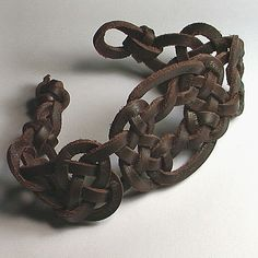 Celtic Knot Bracelet - I wish I could get a belt kind of like this sometime.