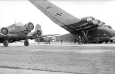 The ME 323 next to a Junkers JU 52, not small plane by itself as that could carry 17 paratroopers!