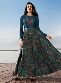 You are sure to make a powerful style statement with this Blue Satin And Georgette designer party wear kurti. The attractive Patchwork, Stonework and Print Work throughout the dress is awe inspiring. Long Gown Dress, The Dress, Indian Gowns Dresses, Indian Outfits, Long Kurtis Online Shopping, Ladies Kurti Design, Prachi Desai, Stylish Dress Designs, Kurti Designs Party Wear