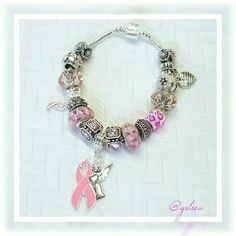 Breast cancer charm bracelet Inspired my mother, my angel, the strongest woman I've ever known, for you or the warrior who has touched your heart ...handmade charm bracelet w .925 core glass charms, Tibetan crystal spacers and pink ribbon charms and a proudly hung made in the usa charm on a ss plated snake barrel clasp chain. Chain can be switched to an adjustable chain. Custom orders welcome. Discounts given on bundles and to returning customers Salty Grace  Jewelry Bracelets
