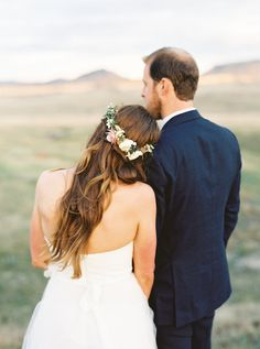Love this bride's floral crown and hairstyle | Colorado Ranch Wedding | Lauren Fair Photography | Bridal Musings
