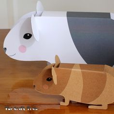*This post contains affiliate links Do you have a soft spot for guinea pigs? Last year we bought two adorable young ones by the names of Bob and Lucy for our daughters, and the moti… Baby Guinea Pigs, Baby Pigs, Boy Printable, Printable Paper, Free Printables, Pig Crafts, Paper Crafts, Craft Activities, Preschool Crafts