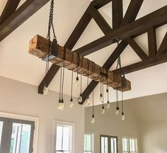 7M's reclaimed barn beam light fixtures combine rustic Americana with modern industrial features. The beams used for these rustic beam light fixture come from century old mid-western barns and may show original saw mill markings, hand hewn cuts, mortise & tenon joinery, checks or other one of a kind features that will set your rustic beam light fixture apart from the others. Rustic Chandelier Lighting, Industrial Chandelier, Edison Lighting, Industrial Lighting, Chandeliers, Edison Bulbs, Rustic Industrial, Rustic Modern, Rustic Wood