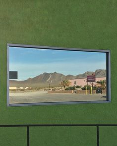 "A window at the Area 51 Travel Center reflects the Alien Cathouse and surrounding mountains in Amargosa Valley Nevada.  This is Ryan Shorosky @ryshorosky taking over as I travel throughout southern Nevada photographing the culture and landscape that surrounds Nellis Air Force Range Nevada Test Site and the supposed ""Area 51"" . by newyorkerphoto"