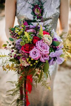 Hand tied wedding bouquet in dreamy jewel tones   Gorgeously Moody Jewel Tone & Metallic Beach Wedding Inspiration   Photograph by The Hursts & Co. See The Full Story at http://storyboardwedding.com/moody-jewel-tone-metallic-beach-wedding/