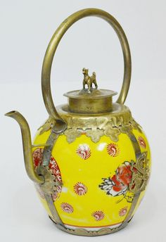 Beautiful yellow Chinese porcelain teapot with Tibetan metal work