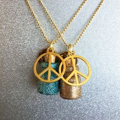 Acrylic and Glitter Hand-Painted Glass Vials w/ Corks and Gold Peace Sign Symbol. 30'' Necklace comes on a 30'' Gold-Plated Chain.