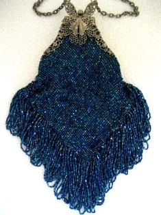 5839b1a6e4e Women's Purses : A charismatic and fashionable antique glass knit beaded  purse, with a butterfly