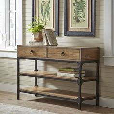 Tanner Console Table | Made with ash veneers and a rustic metal frame, this console table features a casual industrial look. Two levels of wide shelving and a pair of drawers offer both concealed storage and space for display.