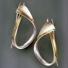 Modern Art Earrings made of sterling silver and 18K Yellow Gold by the anticlastic raising technique; handmade earrings look different from every angle. By Nancy Linkin