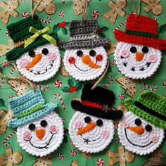 These adorable little snowmen will look perfect hanging from your Christmas tree. You can also tie these sweet little guys on packages for your family and friends. Every year they will hang it on their Christmas tree and remember you! It's never too early to decorate for the holidays! Set of 6 snowmen ornaments (1 of each color as shown). Also available separately. Snowmen are crocheted using white acrylic yarn for the faces and various colors for the hats. Hand stitched faces have button…