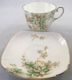 "Rare Loretta Paragon Teacup and Saucer, Double Warrant, Green leaves This set is elegant, shapely and hard to find. Excellent condition No chips cracks or crazing Gold in great condition Measures: Cup opening: 3 1/4"" Including handle: 4 1/5 Saucer: 5 1/5"" *Combined Shipping is"