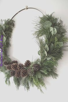 Make a giant DIY rustic Christmas wreath! Making your own Christmas decorations is a great way to decorate for Christmas on a budget, and this large, natural Christmas wreath is no exception. This post shows you how to make your own Christmas wreath using Christmas Wreaths For Windows, Rustic Christmas Ornaments, Noel Christmas, Holiday Wreaths, Simple Christmas, Christmas Crafts, Beautiful Christmas, Large Christmas Wreath, Make Your Own Wreath Christmas
