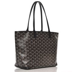 This is an authentic GOYARD Chevron Artois PM in Black. This is a structured tote crafted of goyardine coated canvas with its iconic chevron pattern. This tote features black leather trim including leather strap handles, top edging and protective corner patches. The silver top zipper opens to a spacious off white interior of natural canvas with a hanging patch pocket lined with matching goyardine coated canvas. This is an ideal everyday tote with the sophistication of Goyard. Silver Tops, Hermes Handbags, 1 Month, Chevron, Black Leather, Tote Bag, Purses, Outfits, Accessories