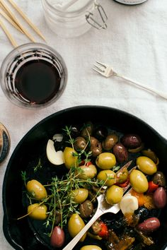 Orange marmalade, thyme and garlic permeate every olive for a robust, addictive bite. Warm olives recipes don't get tastier – or easier – than this one.