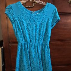 Bright blue floral dress Beautiful blue floral dress that zips up in the back! Urban Outfitters Dresses