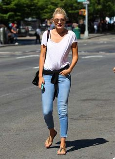 No stranger to the camera of late, model Gigi Hadid flashed a smile while strolling in New York City wearing Mother jeans.