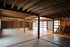 love the floor - cement with wood inlaid drawing the eye from one beam post to the next beam post