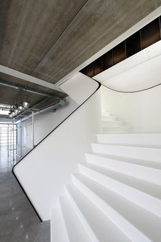 White stairs at the Sanibell Headquarters in The Netherlands by RoosRos Architecten.