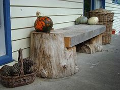 bench from two log chunks and a big hunk of lumber or recycled beam.